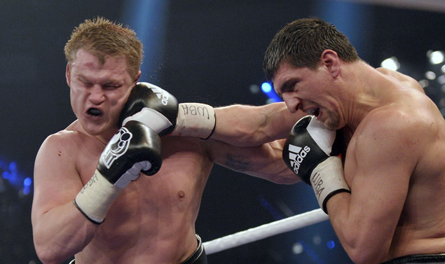German Marco Huck (R) punches Russian ti