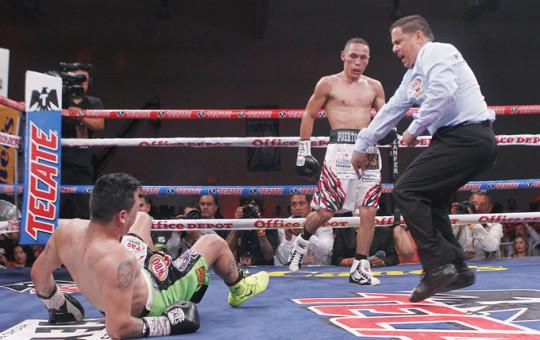 Estrada KOs Marquez in ten to retain WBA/WBO flyweight titles